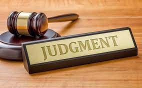 Gavel and plate saying judgment